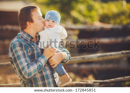 Happy father with his child faving fun in uemmer day outdoors. - stock photo