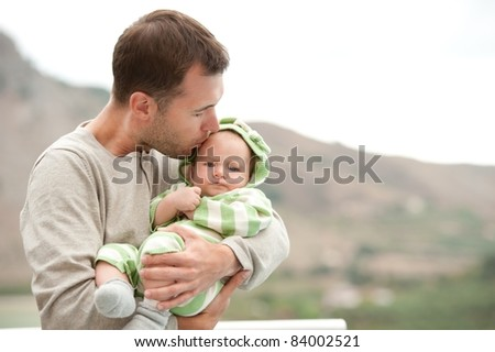 Happy father with his child outdoors. - stock photo