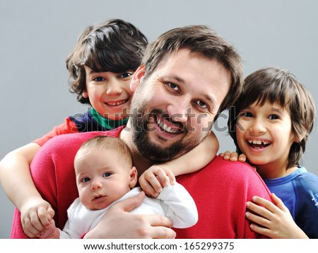 Happy father with his children posing for portrait - stock photo