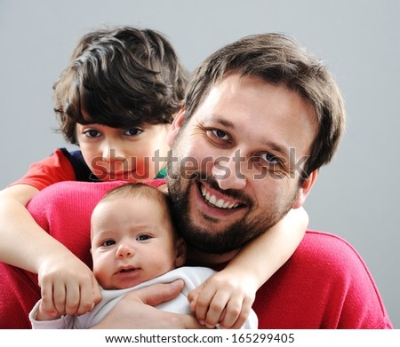 Happy father with his children posing for portrait