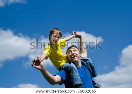 happy father with his son on a background of sky
