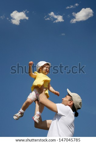 happy father with little daughter outdoors - stock photo