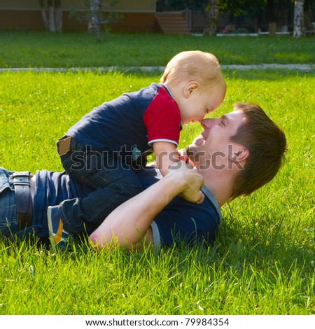 happy father with little son outdoor portrait - stock photo