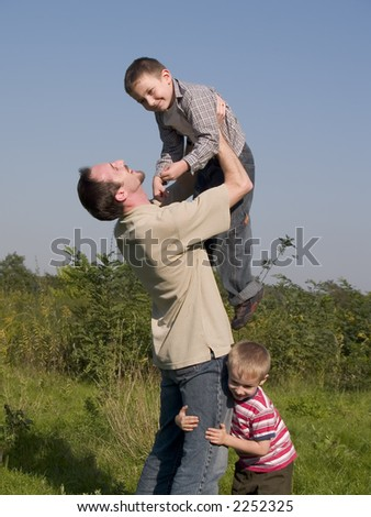 happy father with sons - stock photo