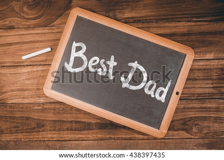 happy fathers day against chalkboard on desk