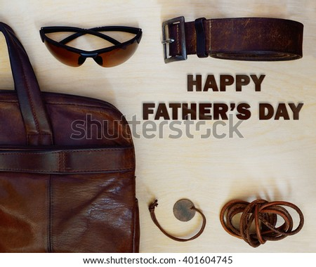 Happy Fathers Day. Man accessories on the light wood table and lettering. Man set.