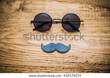 Happy fathers day sticker circle round sunglasses black paper mustache on wooden background