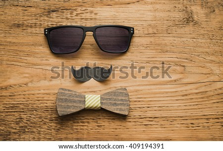 Happy fathers day sticker wooden bow tie glasses black paper mustache on wooden