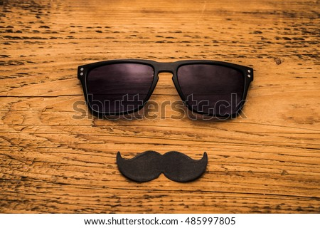 Happy fathers day sticker wooden glasses black paper mustache on wooden background hipsters