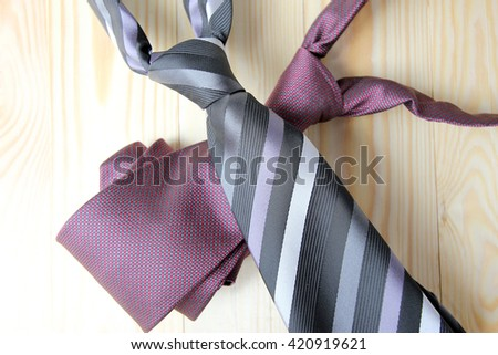 Happy Fathers Day with red, gray and black striped necktie on pime wood background - stock photo
