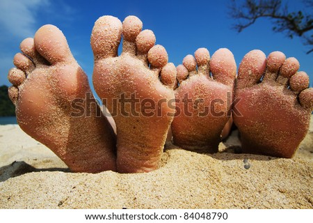 happy feet on the beach - stock photo