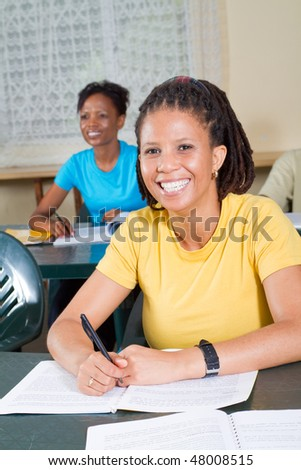 happy female african american adult students in classroom - stock photo