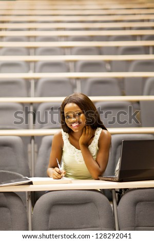 happy female african college student in lecture room - stock photo