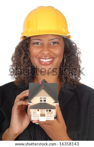 Happy female architect holding a small house model - stock photo