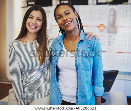 Happy female business owners smiling at camera enjoying success - stock photo