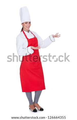 Happy Female Chef Gesturing. Isolated On White