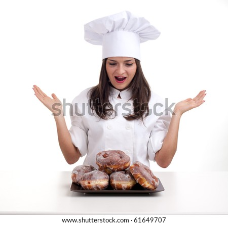 happy female chef in white uniform and hat with doughnuts