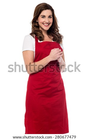 Happy female chef with clasped hands - stock photo
