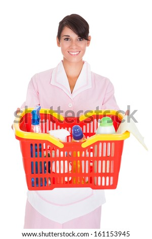 Happy Female Cleaner Holding Bucket With Cleaning Supplies Over White Background - stock photo