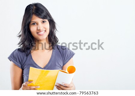 happy female college student reading books - stock photo