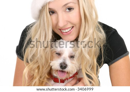 Happy female cuddling a small white maltese terrier