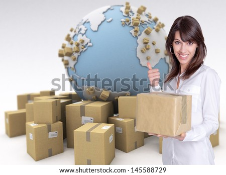 Happy female customer holding a package in an international transport background - stock photo