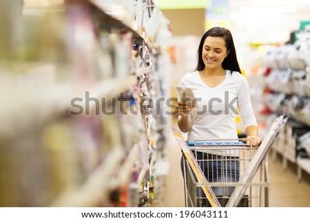 happy female customer shopping in hardware store - stock photo