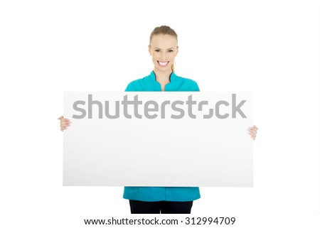 Happy female doctor holding empty banner.