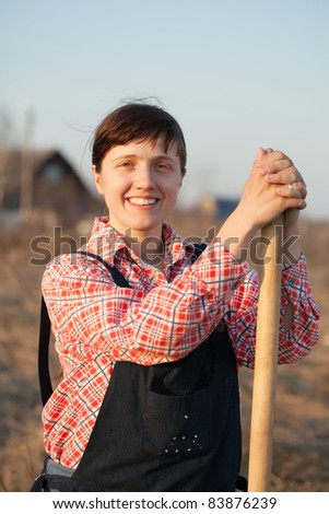 Happy female farmer  with spade  in rural - stock photo