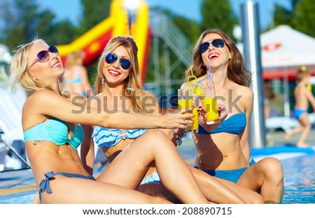 happy female friends enjoying summer near the pool - stock photo