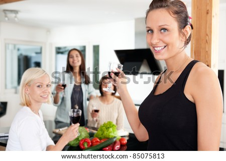 Happy female friends having a casual party at home - stock photo