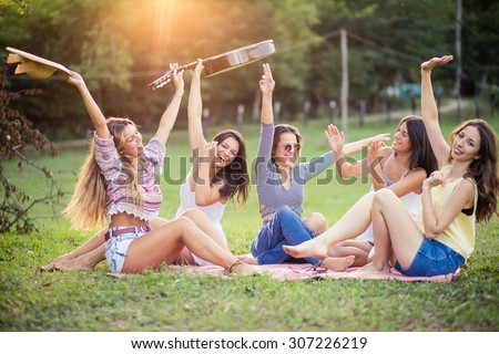 Happy female friends having fun outside in nature.