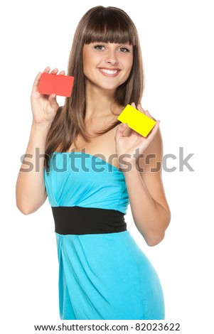 Happy female holding two plastic cards isolated on white background - stock photo