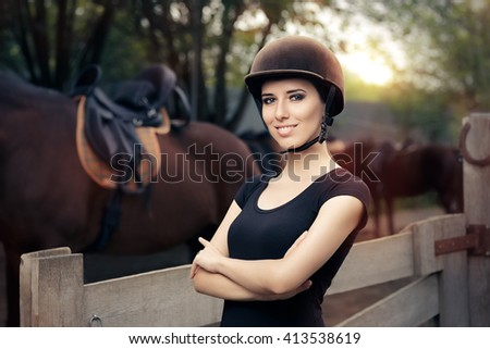 Happy Female Jockey Smiling - Confident woman ready to ride a horse   - stock photo