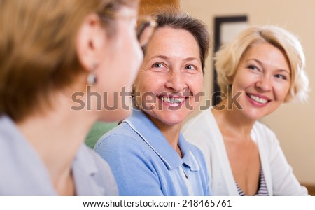happy female pensioners at home - stock photo
