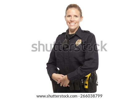 Happy female police officer posing against white - stock photo