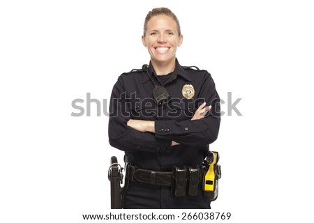 Happy female police officer posing with arms crossed against white background - stock photo