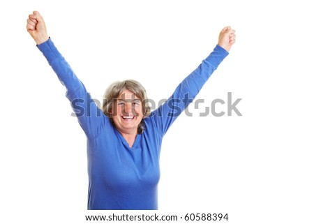 Happy female senior citizen cheering with fists clenched - stock photo