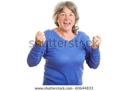 Happy female senior citizen clenching her fists - stock photo