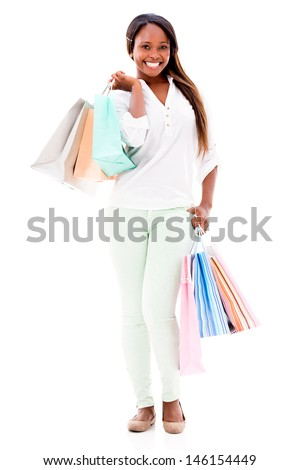 Happy female shopper holding shopping bags - isolated over white background  - stock photo