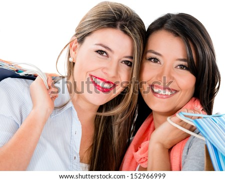 Happy female shoppers smiling - isolated over a white background  - stock photo