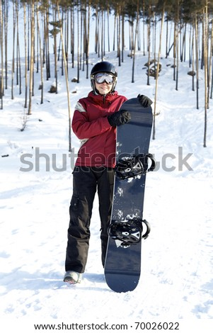 Happy female snowboarder in winter mountains, health lifestyle