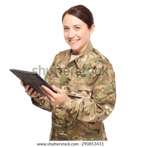 Happy female soldier grinning on white background with digital tablet wearing multicam camouflage. - stock photo