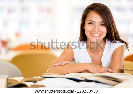 Happy female student at the university smiling - stock photo