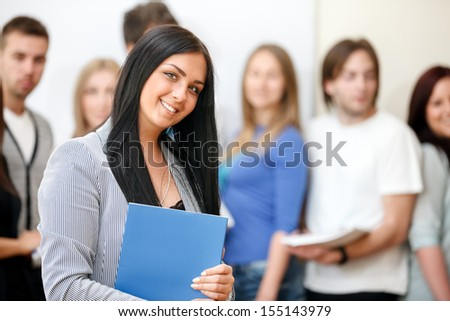 Happy female student holding notebook