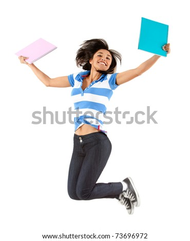 Happy female student jumping - isolated over white - stock photo