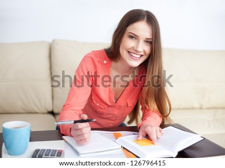 Happy female student learning