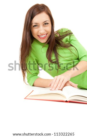happy female student lying down with book, white background - stock photo