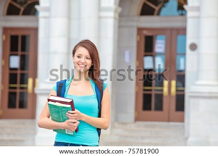 Happy female student on campus