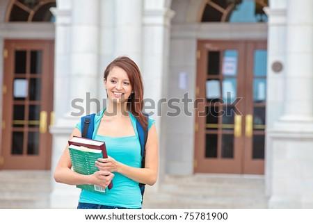 Happy female student on campus - stock photo